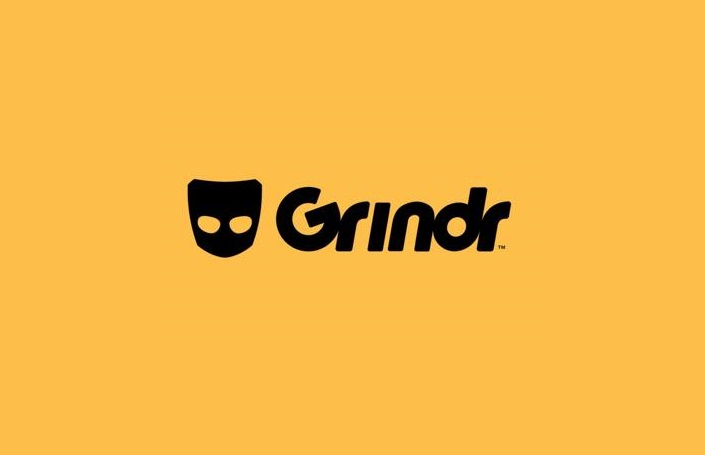 Grindr text in black over yellow background